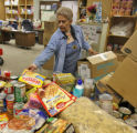 Volunteer Marie Gallegos (cq) sorts canned and boxed goods at the food bank of the Douglas/Elbert...