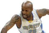 Denver Nuggets guard Anthony Carter bats the ball away from  Milwaukee Bucks guard Mo Williams,...