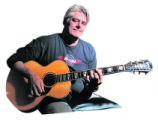 Local Guitar maker Scott Baxendale (cq) ,51, sits in the Colfax Guitar Shop Friday morning Oct....