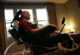 Scott Slade (cq) sits in his wheelchair in the master bedroom of his San Diego home where he...
