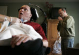 Scott Slade (cq) has a breathing treatment from his nurse Liz Bell (cq) December 8, 2007, which is...