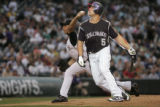 Jeff Francis, #26 of the Colorado Rockies pitches to the Arizona Diamondbacks Friday Sept. 28,...