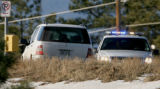 Douglas County crime scene investigators look at a SUV, Monday morning, January 7, 2008, at the...