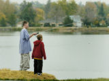 Denver, CO Oct. 21, 2005 Darrian (cq) Gonzalez, 7, (right) watches as his friend Shawn Johnson,...