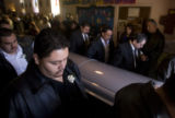 DM0261   The pallbearers carry the casket of Becky Yanez out of the Holy Family Church in Fort...