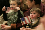 0123 Hannah Schenck, right, watches her uncle Sgt. Don Bonzer as participates in a departure...