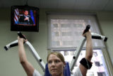 31 year-old Carina Gerety (cq) works out at the YMCA in downtown Denver, as part of her weekly...