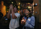 Brett Schwab,(cq) 25 of Den. and Monisha Merchant (cq) the organizer, cheer as Hillary gets 40%...