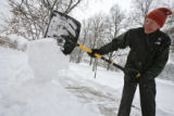 DM0576   Harrison Hayes shovels the sidewalk in front of his house near Washington Park  in...