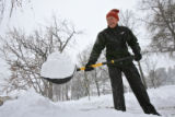 DM0577   Harrison Hayes shovels the sidewalk in front of his house near Washington Park  in...