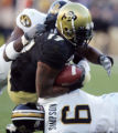 CODZ109 - Colorado fullback Lawrence Vickers, center, is stopped by Missouri free safety Jason...