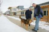 Silver Sage resident Susan Booker, left, runs into Dan Knifong, another resident, while she walks...