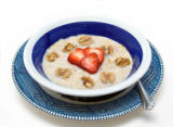 Health concept - oatmeal, walnuts and heart-shaped strawberry slices.