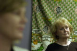 (LEFT; out of focus) Valerie Jarstad(cq) listens to the press conference with Loretta Kilgore,...