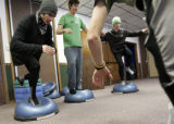 L-R  Spencer Reeves, Erik Stumpf and Sam Trippe, work on a balancing exercise on bosa balls in the...