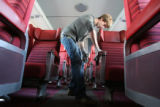 Jack Bain, cq, 16 years-old, wipes down the interior of a passenger train car, Wednesday Dec. 26,...