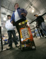 Ned Worehrle ,13 and his mom Kate Finegan return a guitar hero at Best Buy in Denver, Colo. on...