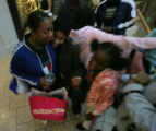 Priscilla Cleckley (cq) gives her cousin Sheldyn Merrell, 13 (cq) a hug after her shopping...