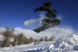DM0047   Patrick Dickinson, 29, flies off a jump in Lakewood Gulch in Denver, Colo. Wednesday,...