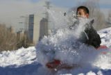 DM0493   Snow flies as Jonathan Ponce plows through a jump instead of sailing off of it while...