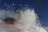 DM0496   Snow flies as Jonathan Ponce plows through a jump instead of sailing off of it while...