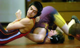 ERIC BELLAMY/ebellamy@greeleytribune.com Greeley West High School's Aaron Andrade, left, pins...