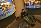 DM0303   Michael Wisner, 44, of Snowmass sits at Denver International Airport after his son Jake...