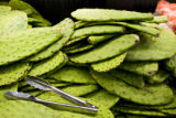 Nopal con Espinas, known as prickley pear cactus pads are stacked in the fresh produce section at...