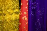Fabric hangs from the walls at Tan Tai fabric store at 1091 S. Federal Blvd., Denver, Colo., on...