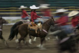 Member of the Las Potrancas riders practice for Mexican Rodeo Extravaganza, Firday night, January...