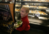 Evan Stuart, 3 looks at his mom Amy Stuart of Highlands Ranch as he hold his salad bowl at Mad...