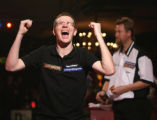 LON810 - Wales' Mark Webster celebrates beating Australia's Simon Whitlock during their BDO World...