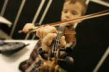 0273 0262 Dale McCurdy, 5, of Franktown, practices for a performance with the Fiddlocity Fiddle...