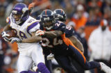 [ JPM635 ] Denver Broncos Champ Bailey pulls down Minnesota Vikings Robert Ferguson (89) in the...
