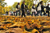 Runners and walkers make their way through Washington Park on a cool autumn Sunday morning October...