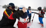 (Leadville, Colo., Jan. 6, 2008) Ski instructor Kevin Zink helps a student with his goggles.  Ski...
