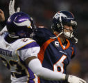 [ JPM426 ] Denver Broncos quarterback Jay Cutler shoves Minnesota Vikings Cedric Griffin in the...
