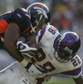 [ JPM162 ] Denver Broncos Kenny Peterson, left, brings down Minnesota Vikings Adrian Peterson on...