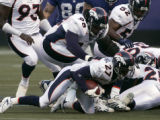 Darrent Williams recovers a fumble in the 1st quarter of the Denver Broncos against the New York...