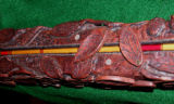 Jeff Hatton, of Paonia, carved this replica form-fit rod case with locking leaves in a fanciful...