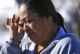 DM0287   Norma Kaholo wipes away tears as she weeps for her 11-year-old niece Angelica Martinez...