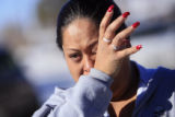 DM0299   Norma Kaholo wipes away tears as she weeps for her 11-year-old niece Angelica Martinez...