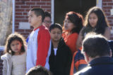 DM0374   Family members, friends and neighbors of Angelica Martinez, 11, watch from down the...