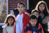 DM0371   Family members, friends and neighbors of Angelica Martinez, 11, watch from down the...