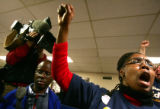 Supporters cheer for Democratic Presidential candidate John Edwards meets with volunteers at the...