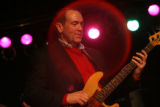 "MJM909 Mike Huckabee plays a bass during a song with ""The Boogie Woogers"" band during a..."