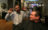 Philip Fiorechats with  20 years customer Greg Dormaier at his salon in Denver, Colo. Thursday,...