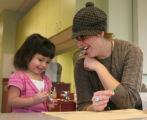 Full time volunteer Betsy Fulnecky (cq), right, plays with two year old Isabelle Sandovol, in...