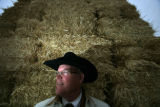 Pat Grant stands by a load of hay bales at the National Western Stock Show complex in Denver,...