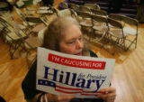 Hillary supporter Wendy Gibson holds a sign as she c aucuses at the State Historical Building in...